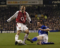 Photo. Jed Wee.<br /> Everton v Arsenal, FA Barclaycard Premiership, Goodison Park, Liverpool. 07/01/2004.<br /> Everton's Gary Naysmith (R) slides in to tackle Arsenal's Freddie Ljungberg.