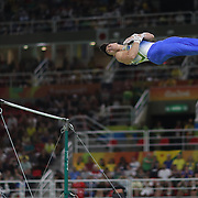 Gymnastics - Olympics: Day 3  Sergio Sasaki #112 of Brazil performing his Horizontal Bar routine during the Artistic Gymnastics Men's Team Final at the Rio Olympic Arena on August 8, 2016 in Rio de Janeiro, Brazil. (Photo by Tim Clayton/Corbis via Getty Images)