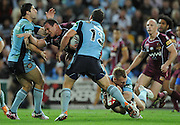 July 6th 2011: Matthew Scott of the Maroons is tackled during game 3 of the 2011 State of Origin series at Suncorp Stadium in Brisbane, QLD, Australia on July 6, 2011. Photo by Matt Roberts / mattrimages.com.au / QRL