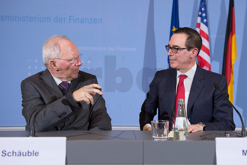 """16 MAR 2017, BERLIN/GERMANY:<br /> Wolfgang Schaeuble (L), CDU, Bundesfinanzminister, und Steven Terner """"Steve"""" Mnuchin (R), Fianzminister der Vereinigten Staaten von Amerika, USA, im Gespraech, nach einer Pressekonferenz nach einem gemeinsamen Treffen, Bundesministerium der Finanzen<br /> IMAGE: 20170316-03-030<br /> KEYWORDS: Wolfgang Schäuble, Steve Mnuchin, Treasury secretary, Gespräch"""