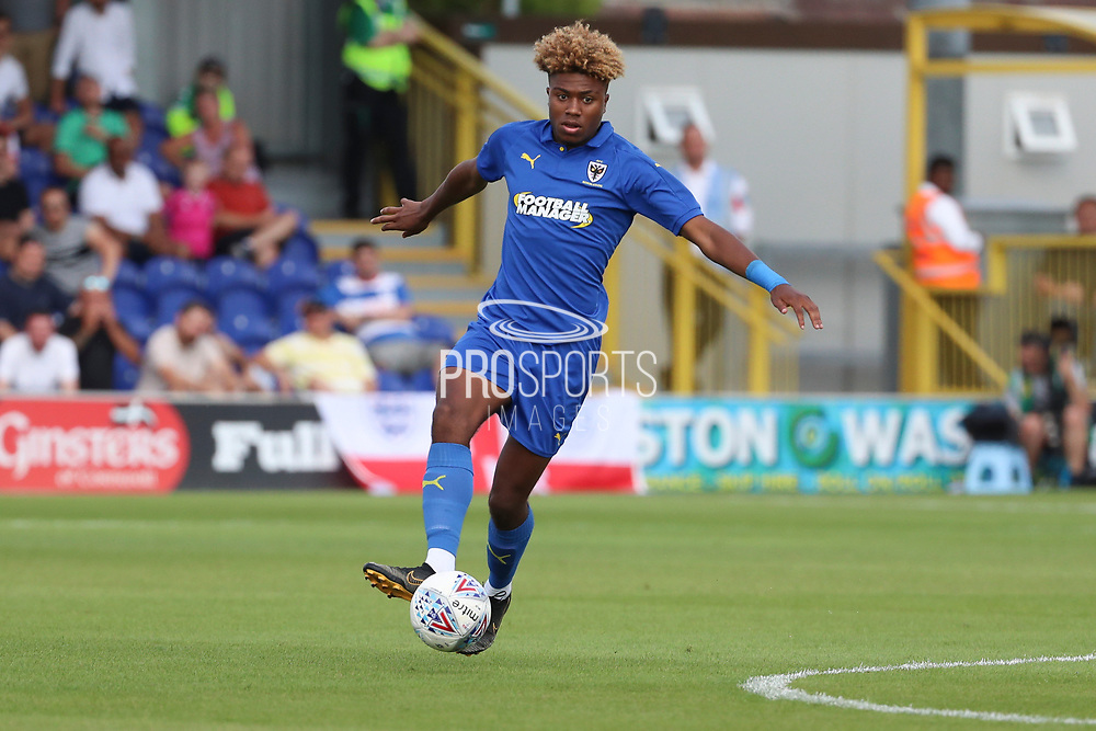 AFC Wimbledon midfielder Ossama Ashley (36) dribbling during the Pre-Season Friendly match between AFC Wimbledon and Queens Park Rangers at the Cherry Red Records Stadium, Kingston, England on 14 July 2018. Picture by Matthew Redman.