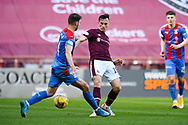 Sean Walsh (#4) of Inverness Caledonian Thistle FC tackles Aaron McEneff (#18) of Heart of Midlothian FC during the SPFL Championship match between Heart of Midlothian and Inverness CT at Tynecastle Park, Edinburgh Scotland on 24 April 2021.