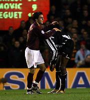 Photo: Chris Ratcliffe.<br /> Arsenal v Juventus. UEFA Champions League. Quarter-Finals. 28/03/2006.<br /> Cesc Fabregas keeps the lid on Patrick Vieira