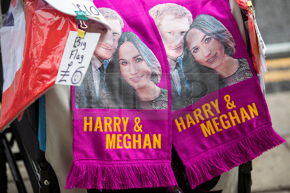 © Licensed to London News Pictures. 16/05/2018. Windsor, UK. Prince Harry and Meghan Markle scarves on sale outside Windsor Castle ahead of the Royal Wedding. Prince Harry and Meghan Markle are to be married on Saturday in Windsor. Photo credit: Rob Pinney/LNP