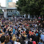 """Rapper Anthony """"King Flyz"""" Cornett speaks to protesters prior to a Black Lives Matter march, Saturday, August 26, 2017, in Seattle, Washington. Several thousand people attended a downtown rally and then marched through the city to call attention to minority rights and police brutality. (Alex Menendez via AP)"""