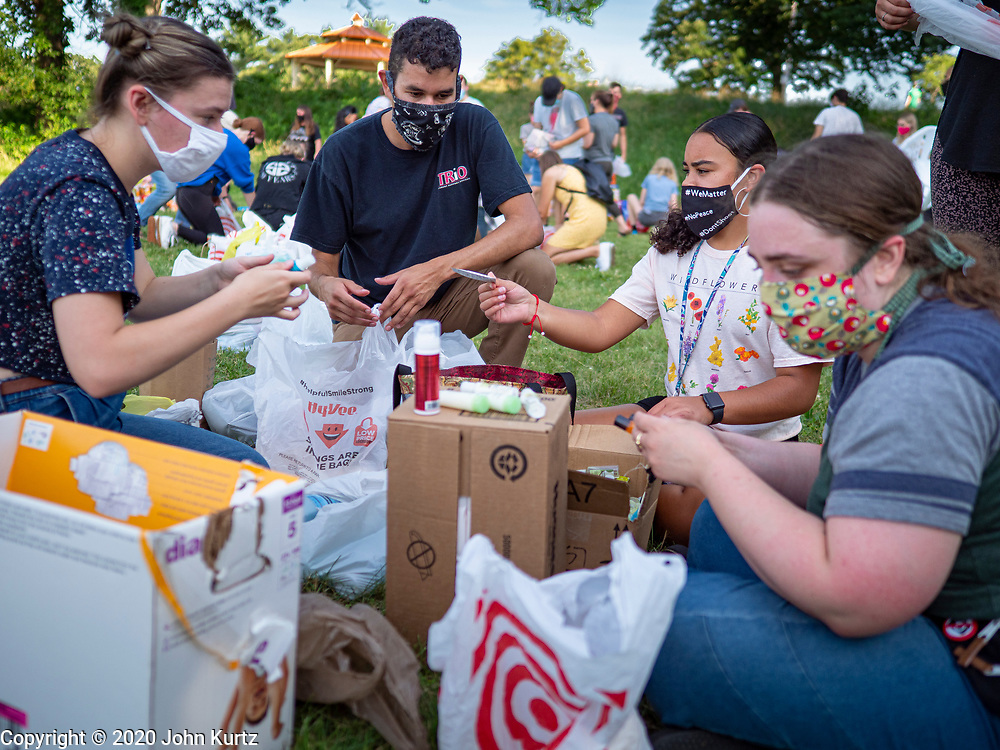 25 JUNE 2020 - DES MOINES, IOWA: Supporters of Black Lives Matter sort shampoo and toiletries donated to BLM to help the homeless. Nearly 100 volunteers came to a community support event organized by Black Lives Matter in Good Park in Des Moines. They sorted supplies donated to BLM, including food, sanitary supplies, first aid supplies, batteries, blankets, tents, and bottled water. The emergency packages will be distributed to homeless people in Des Moines.        PHOTO BY JACK KURTZ