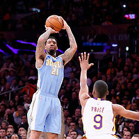 23 November 2014: Denver Nuggets forward Wilson Chandler (21) takes a jump shot over Los Angeles Lakers guard Ronnie Price (9) during the Los Angeles Lakers season game versus the Denver Nuggets, at the Staples Center, Los Angeles, California, USA.