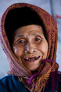 An elderly neighbor of rice farmer Nguyen Van Theo, in Tho Quang Village, Vietnam.  (Nguyen Van Theo is featured in the book What I Eat: Around the World in 80 Diets.)