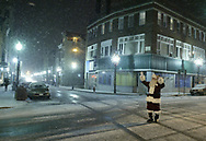 Times Herald-Record/TOM BUSHEY<br /> Santa waves to traffic from the center of Franklin Square in Middletown last night after appearing at the city's Holiday Tree Lighting ceremony. Snow started falling during the ceremony.<br /> Dec. 5, 2003.