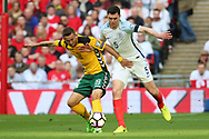 Michael Keane of England battles for possession with Nerijus Valskis of Lithuania during the FIFA World Cup Qualifier group stage match between England and Lithuania at Wembley Stadium, London, England on 26 March 2017. Photo by Matthew Redman.