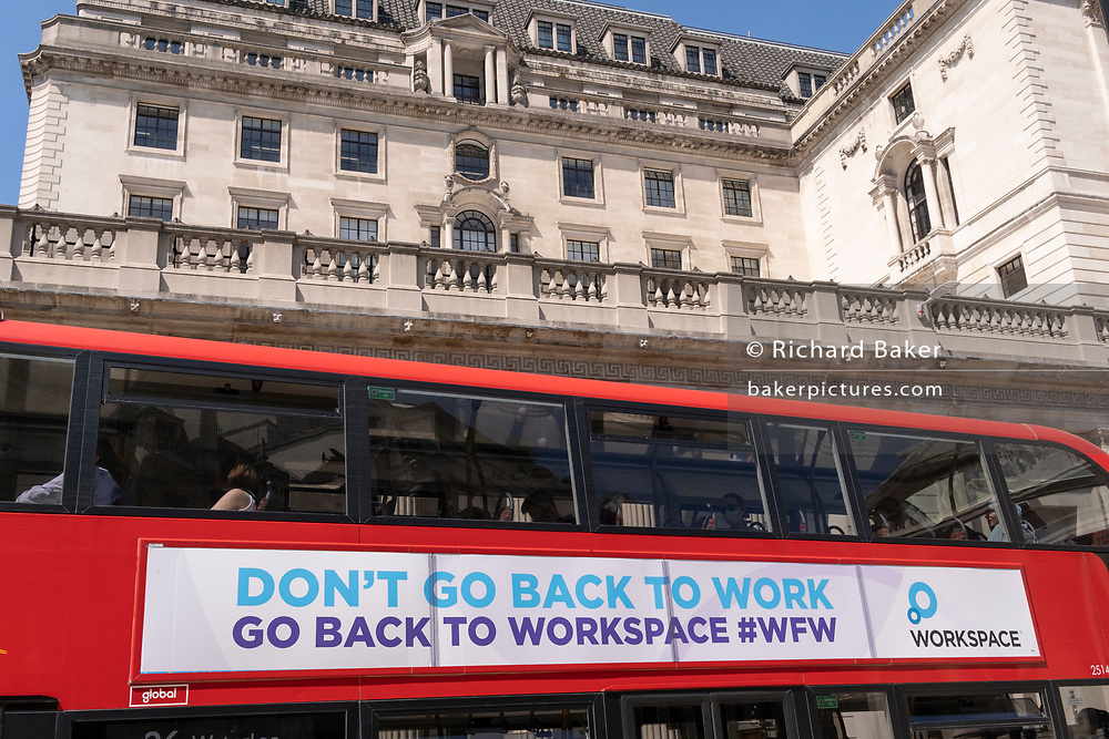 Now that workers are gradually returning to their office workplaces after a year of Covid lockdown restrictions,  a banner on the side of a London bus advertises the property company 'Workspace', alongside the Bank of England in the City of London, the capital's financial district, on 8th June 2021, in London, England. 'Workspace' is a real estate investment trust that  lets office, industrial and workshop space to small and medium-sized enterprises.