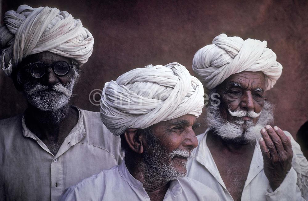 Portait of three Bishnoi caste village elders, Guda Vishnoyan village, Rajasthan, India