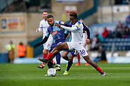Jamal Lowe of Portsmouth under pressure from Curtis Thompson of Wycombe Wanderers during the EFL Sky Bet League 1 match between Wycombe Wanderers and Portsmouth at Adams Park, High Wycombe, England on 6 April 2019.