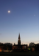 Goshen, New York - A crescent moon and Venus, at right, shine above a church steeple at twilight on June 15, 2010.