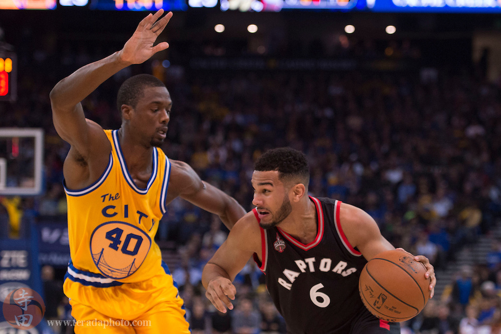 November 17, 2015; Oakland, CA, USA; Toronto Raptors guard Cory Joseph (6) dribbles the basketball against Golden State Warriors forward Harrison Barnes (40) during the second quarter at Oracle Arena.