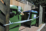 CLAYGATE SURREY. Rubbish bins taped up by police near Mrs Challen's house in Ashton place, Claygate. The couple were seperated. UK. A 56-year-old woman is being questioned on suspicion of murder after a man in his 60s was found dead in suspicious circumstances in Surrey.The body was discovered by officers who were called to an address in Ruxley Ridge, Claygate, near Esher. 16 August 2010. STEPHEN SIMPSON..