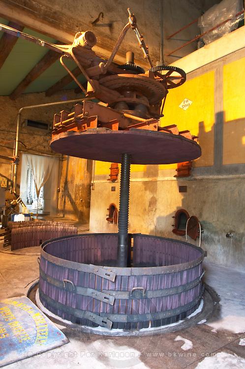 Chateau Mire l'Etang. La Clape. Languedoc. An old vertical basket press. Concrete fermentation and storage vats. Wine press. France. Europe.