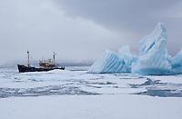 MS Stockholm next to iceberg in arctic, Svalbard, Norway.