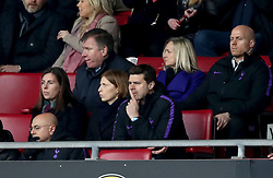 Tottenham Hotspur manager Mauricio Pochettino (centre) appears dejected in the stands at the end of the Premier League match at St Mary's Stadium, Southampton.