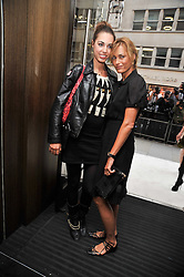 Left to right, AMBER LE BON and her mother YASMIN LE BON at a reception hosted by Vogue and Burberry to celebrate the launch of Fashions Night Out - held at Burberry, 21-23 Bond Street, London on 10th September 2009.