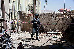 June 16, 2017 - An Afghan security force member inspects the site of an attack at Al-Zahra Mosque in Kabul, capital of Afghanistan, June 16, 2017. At least four civilians were killed and seven others wounded after two suicide bombers struck a local mosque in Afghanistan's capital of Kabul on Thursday night, an Interior Ministry official said. (Credit Image: © Rahmat Alizadah/Xinhua via ZUMA Wire)