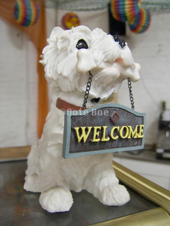 dog figurine with bone and welcome sign