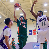 011715       Cable Hoover<br /> <br /> Wingate Bear Brandon Lewis (42) grabs a rebound from Miyamura Patriot Leo Mitchell (11) at Miyamura High School Saturday.