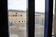 A view from a window of a yard at  HMP Bronzefield, a private prison run by Sodexo Justice Services on the outskirts of Ashford in Middlesex, United Kingdom. HMP Bronzefield is an adult and young offender female prison, the only purpose built private prison solely for women in the UK and is the largest female prison in Europe. (photo by Andy Aitchison)