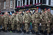Military Tattoo marches down through the Royal Mile during the day at the Edinburgh Festival.