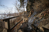 Cornwall, New York - A wooden platform and stair on the trail at Storm King Mountain State Park on March 27, 2010. The Hudson River is visible through the trees at left.