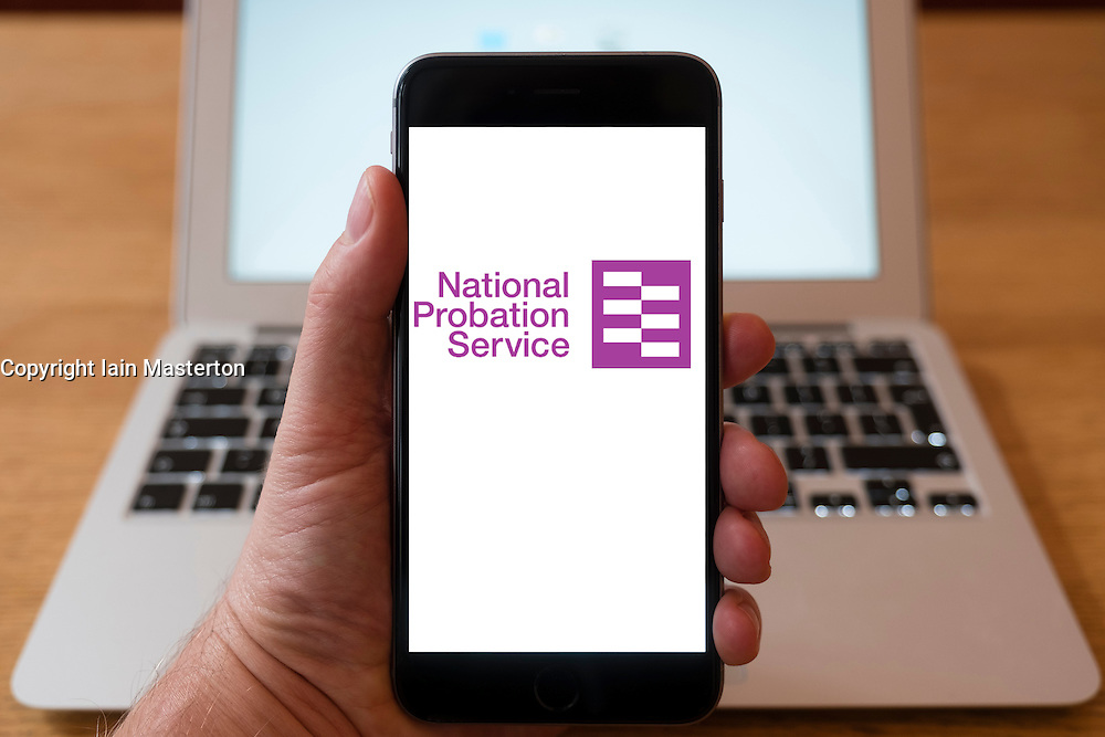 Using iPhone smartphone to display logo of the National Probation Service, UK government