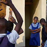 Children at the Mutenda Primary School in drought-hit Masvingo Province, Zimbabwe, wait for their turn to use the toilet.  <br /> <br /> Drought in southern Africa is devastating communities in Zimbabwe, leaving 4 million people urgently in need of food aid. The government declared a state of emergency,. <br /> <br /> Here in Masvingo Province, the country's hardest hit province, vegetation has wilted, livestock is dying, and people are at serious risk of famine. <br /> <br /> Pictures shot by Justin Jin