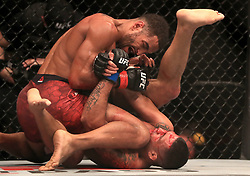Claudio Silva (bottom) and Danny Roberts in action during their Welterweight bout during UFC Fight Night 147 at The O2 Arena, London.