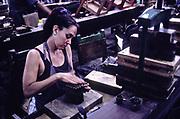 Woman makes cigars in factory in Santa Clara, Cuba