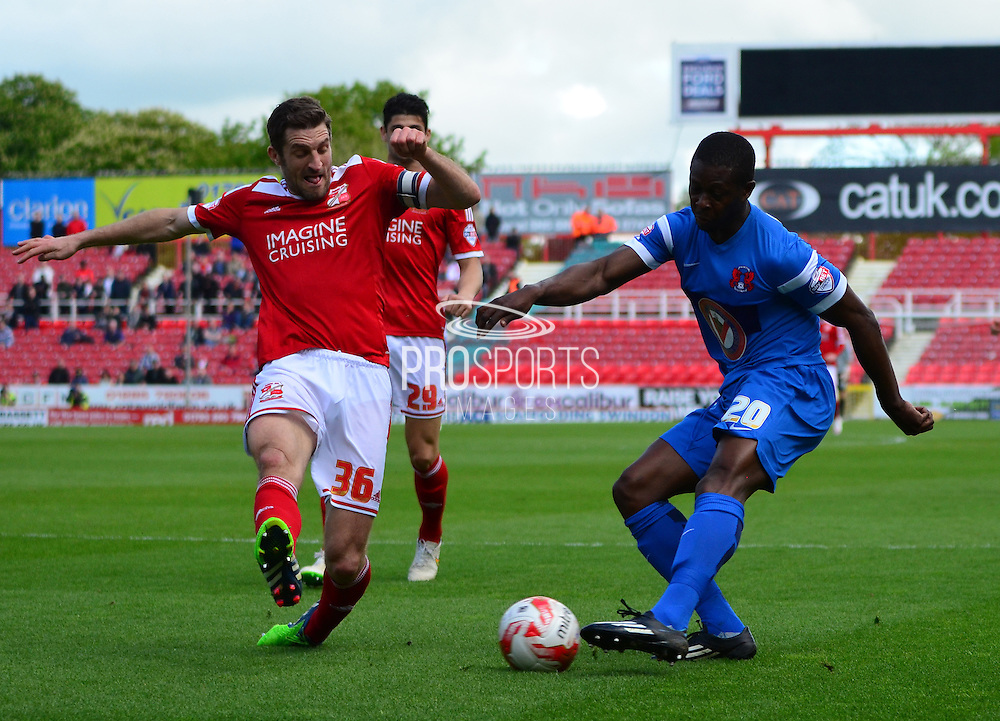 Samuel Ricketts attempts to block Marvin Bartley's cross during the Sky Bet League 1 match between Swindon Town and Leyton Orient at the County Ground, Swindon, England on 3 May 2015. Photo by Alan Franklin.