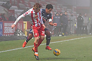 Stevenage midfielder Arthur Read(19) and Swansea City midfielder Wayne Routledge(15) battles for possession during the FA Cup match between Stevenage and Swansea City at the Lamex Stadium, Stevenage, England on 9 January 2021.