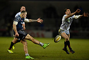Saracens fly-half Alex Lozowski charges down a clearance kick from Sale Sharks centre Mark Jennings during the Aviva Premiership match Sale Sharks -V- Saracens at The AJ Bell Stadium, Salford, Greater Manchester, England on Friday, February 16, 2018. (Steve Flynn/Image of Sport)