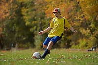 Russell Laman practicing soccer in the fall.