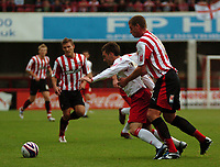 Photo: Tony Oudot.<br /> Brentford v Lincoln City. Coca Cola League 2. 27/10/2007.<br /> Matt Haywood of Brentford holds on to Lee Frecklington of Lincoln