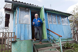 April 24, 2015 - Chernobyl, Ukraine - Ukraine. Pripyat. Chernobyl. Jevgenie Markovitjs. 77 years old. Several hundred elderly people called samosels (self-settlers or autonomous returnees) have returned to their homes within the Zone after being evacuated after the nuclear accident in 1986. They are hardy soles who survive on their own, with little to no help from the government. (Credit Image: © Hans Van Rhoon/ZUMA Wire/ZUMAPRESS.com)