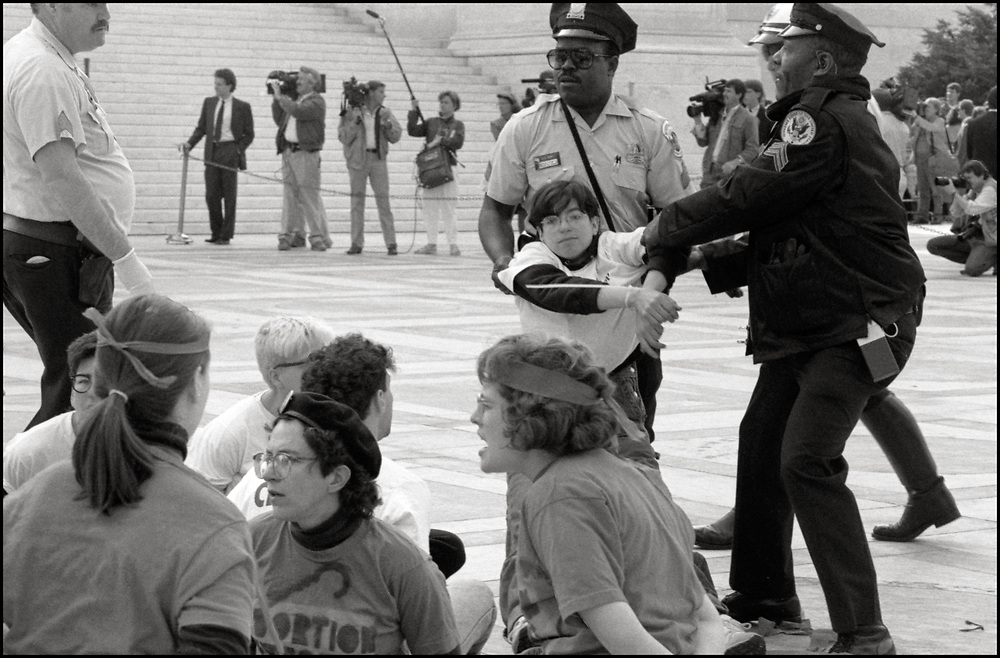 Alexis Danzig of ACT UP NY and Wham! was arrested, on April 26, 1989, when abortion rights opponents, backed by the Bush Administration, urged the Supreme Court to overturn Roe v. Wade in Webster v. Reproductive Health Services. Pro-choice activists clashed with opponents outside the court, with more than two dozen demonstrators were arrested. <br /> <br /> In Webster v. Reproductive Health Services, the Court upheld several provisions of a Missouri law that regulated the performance of abortions.   The Court refused to invalidate the law's preamble stating that life begins at conception.
