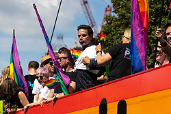 © Licensed to London News Pictures . 05/08/2018. Leeds, UK. ITV Emmerdale bus on the parade . Leeds Gay Pride parade through the Yorkshire city's centre . Leeds's annual Gay Pride festiva celebrates the city's LGBTQ+ life and culture . Photo credit: Joel Goodman/LNP