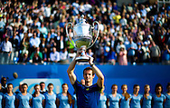 Britain's Andy Murray poses with the trophy, after winning the Aegon Championships at the Queen's Club in London, Britain, 15 June 2013. EPA/BOGDAN MARAN