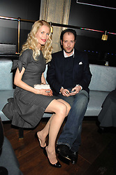 CLAUDIA SCHIFFER and MATTHEW VAUGHN at a party to launch the Dom Perignon OEotheque 1995 held at The Landau, Portland Place, London W1 on 26th February 2008.<br /><br />NON EXCLUSIVE - WORLD RIGHTS