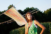 """CLYDE, NY - JULY 21: Jamie Arliss, 33, watches the sunset from her backyard in rural Clyde, New York on July 21, 2011. Occasionally called """"Super Glue Lady"""" by  friends, Arliss survived an arteriovenous malformation in her heart through a unique form of treatment involving the injection of special surgical glue into her veins."""