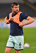 portrait of Eoghan O'Connell captain of Rochdale (6)  warms up before the EFL Sky Bet League 1 match between Hull City and Rochdale at the KCOM Stadium, Kingston upon Hull, England on 2 March 2021.
