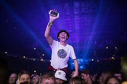 "© Licensed to London News Pictures . 09/09/2017. Manchester , UK . The crowd during Pixie Lott's stage performance - a man holds his phone reading ""Pixie send nudes"" from the crowd . We Are Manchester reopening charity concert at the Manchester Arena with performances by Manchester artists including  Noel Gallagher , Courteeners , Blossoms and the poet Tony Walsh . The Arena has been closed since 22nd May 2017 , after Salman Abedi's terrorist attack at an Ariana Grande concert killed 22 and injured 250 . Money raised will go towards the victims of the bombing . Photo credit: Joel Goodman/LNP"