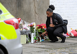 © Licensed to London News Pictures. 04/04/2018. London, UK. A woman looks at flowers placed on Chalgrove Road, Tottenham, north London, at the scene where 17 year old Tanesha Melbourne was shot dead on Monday. A recent spree of killings in the capital has taken the murder toll for the year so far to 48. Photo credit: Ben Cawthra/LNP