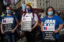 NHS staff prepare to march from St Thomas' Hospital to Downing Street to protest against the NHS Pay Review Body's recommendation of a 3% pay rise for NHS staff in England on 30th July 2021 in London, United Kingdom. The protest march was supported by Unite the union, which has called on incoming NHS England Chief Executive Amanda Pritchard to ensure that a NHS pay rise comes from new Treasury funds rather than existing NHS budgets and which is shortly expected to put a consultative ballot for industrial action to its members.
