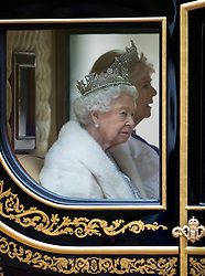 © Licensed to London News Pictures. 14/10/2019. London, UK. Queen Elizabeth II rides the Diamond Jubilee Coach with Camilla, Duchess of Cornwall, along The Mall to The Palace of Westminster for the State Opening of Parliament. Photo credit: Peter Macdiarmid/LNP